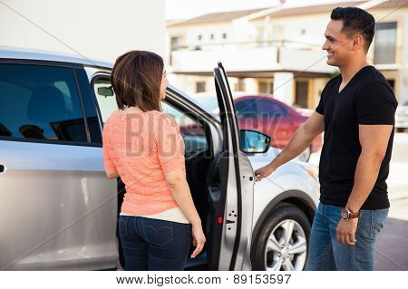 Man Opening Door To Woman
