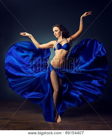 Beautiful girl with great body dances the dance of the belly