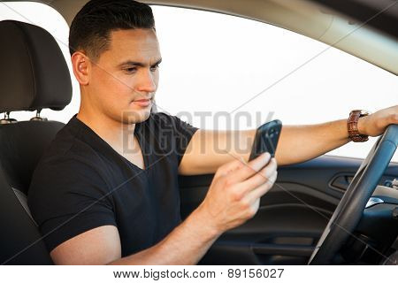 Latin Man Texting And Driving