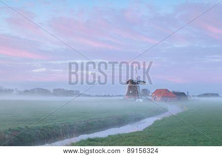 Dutch Windmill In Dense Morning Fog