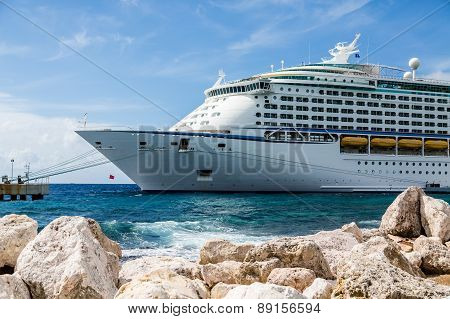 Front Of Cruise Ship Moored Beyond Rock Seawall
