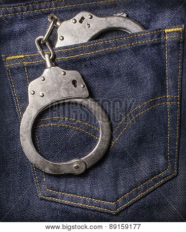 Handcuffs In The Back Pocket Of Jeans