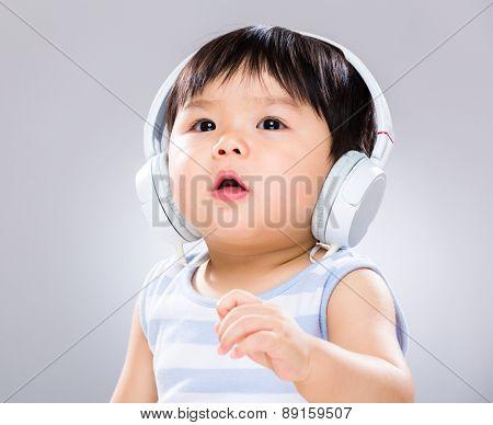 Little boy enjoy listen to music