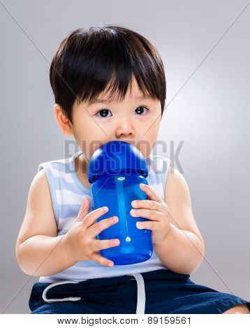 Baby boy drinking water