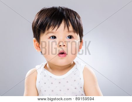 Asian baby boy looking at other side