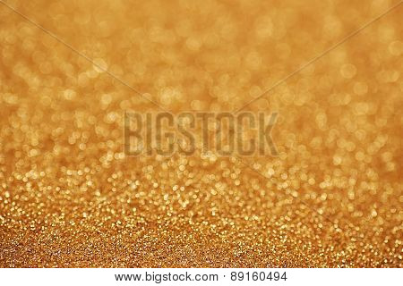 Gold nuggets sparkling carpet. Close-up view, very shallow deep of field . Macro.