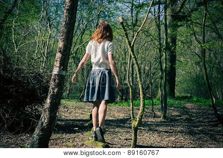 Young Woman Exploring A Forest