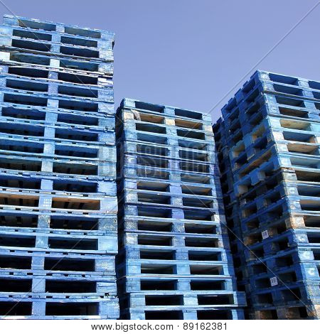 Blue Pallets In Sunshine With Blue Sky