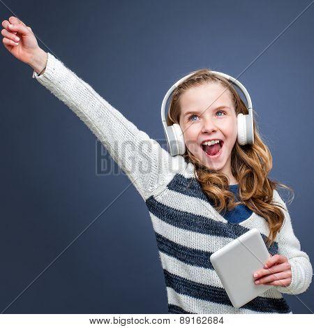 Cute Girl Wearing Head Phones Shouting.