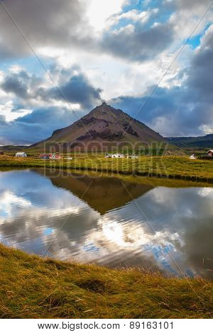Quiet summer evening on Iceland. Sunset in the fishing village of Arnastapi