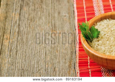 Isolated Bowl With Brown Rice And Leaf Of Parsley