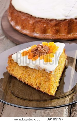 Piece Of Carrot Pie With Icing On Glass Plate