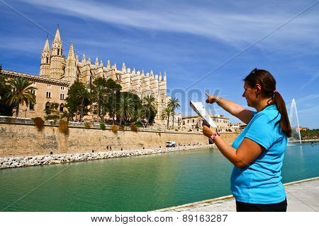 A Tourist In Front Of Majorca Palma Cathedral  At Balearic Islands Spain