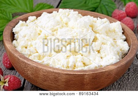 Fresh Curd Cheese In Wooden Bowl