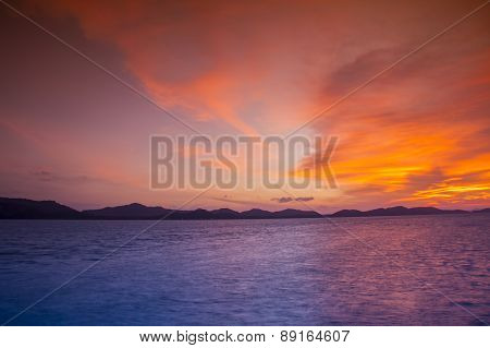 Sunset At The Beach And The Mountains A Beautiful