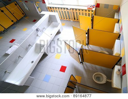Kindergarten Bathroom With Washbasins And Cabins