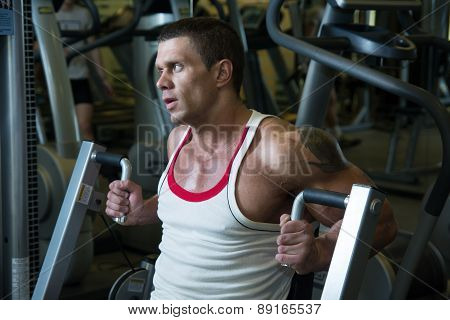 Close-up Portrait Of A Muscular Man In The Gym