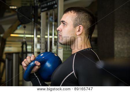 Kettlebell Swing Workout Training Man At Gym.