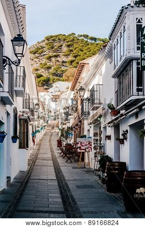 Charming Whitewashed Narrow Street In Mijas
