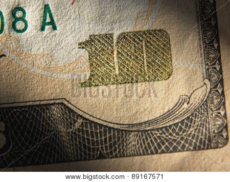 The fragment of 10 dollar bill. Close up