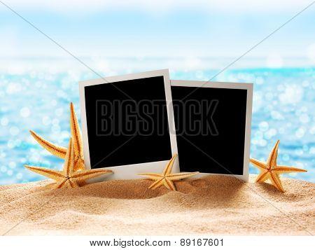 Photo card on sand beach.Close up