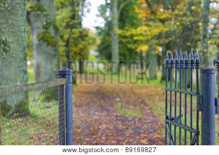 Fragment Of Beautiful Decorative Fence In Autumn Park