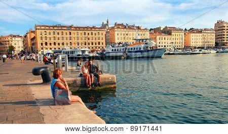 Marseille - July 2, 2014: Old Port (vieux-port) With People Sitting On The Quay On July 2, 2014, Mar