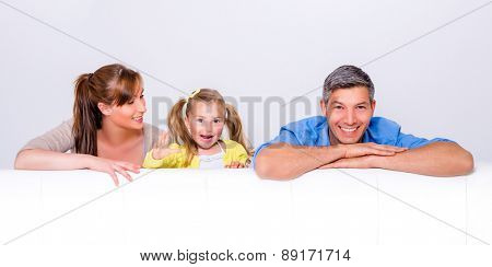 smiling over the sofa looking family