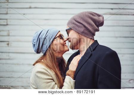 Romantic dates touching by noses