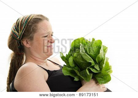 pregnant girl doesn't like healthy food lettuce isolated on white background