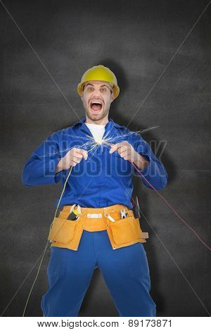 Repairman screaming while holding wires against black wall