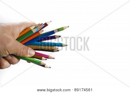 hand holding colorful pencils isolated on white background
