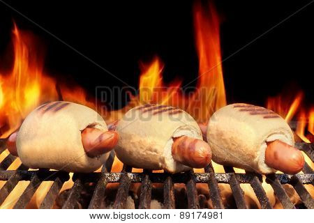 Three Hot Dogs On Flaming Bbq Grill