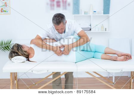 Doctor massaging his patient back in medical office