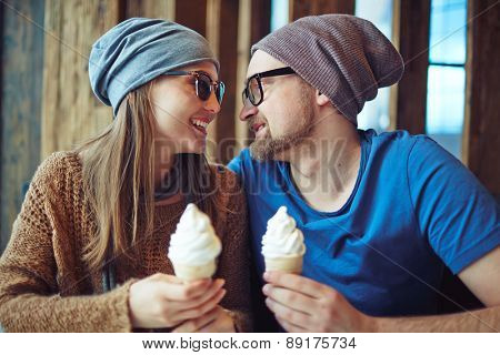 Affectionate dates with ice-cream sitting in cafe