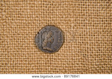 Antique  Coin With Portrait Of Emperor On Old Cloth