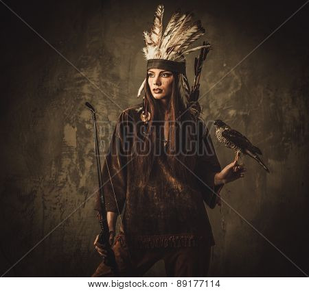Indian woman hunter with bow and pet hawk
