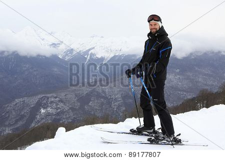 Skier on top of the Aibga Ridge.