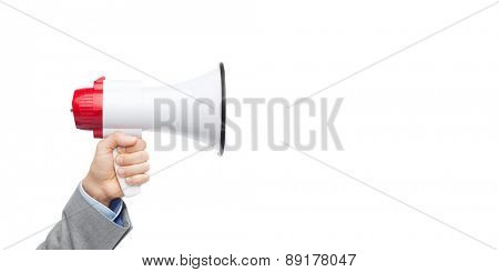 business, people and public announcement concept - closeup of male hand in suit with megaphone