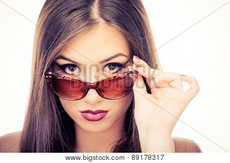 Young beautiful woman with sunglasses on a white background