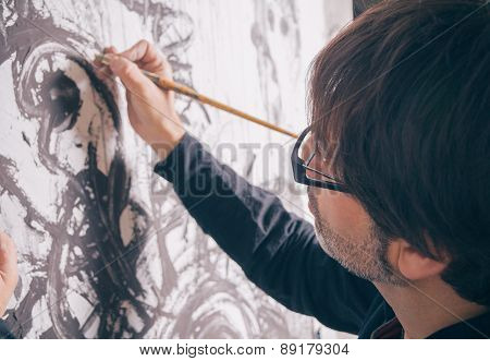 Painter artist working in modern oil canvas