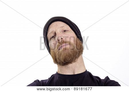 portrait of handsome young man with red beard against white background