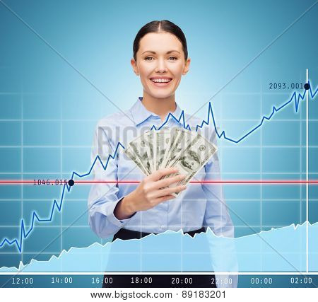 business and money concept - young businesswoman with dollar cash money and chart over blue background