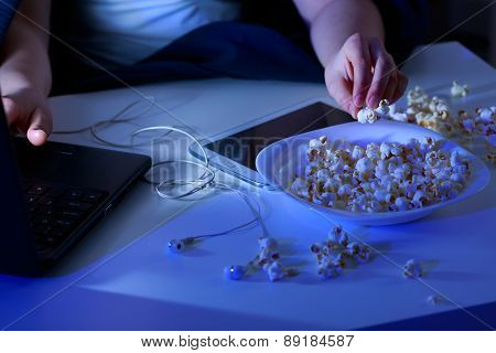 Laptop And Bowl Of Popcorn