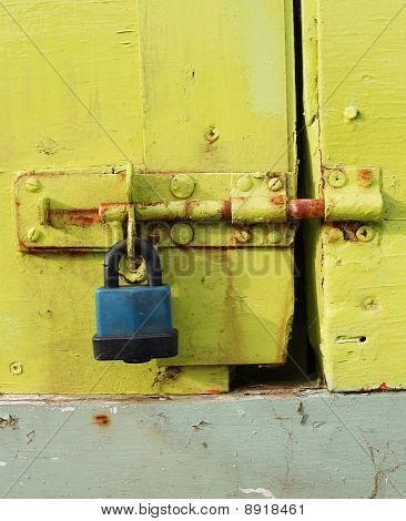 Padlock On A Painted Door