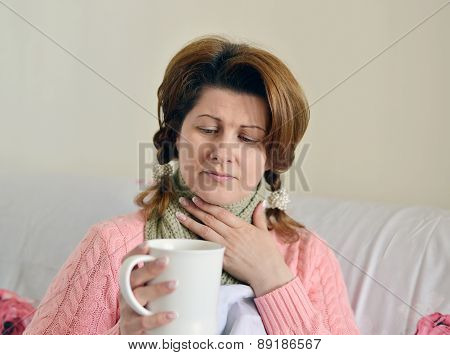 Woman With Flu Symptoms Holding A Cup In  Hand