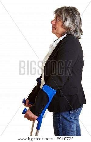 Elderly Woman Using Crutches