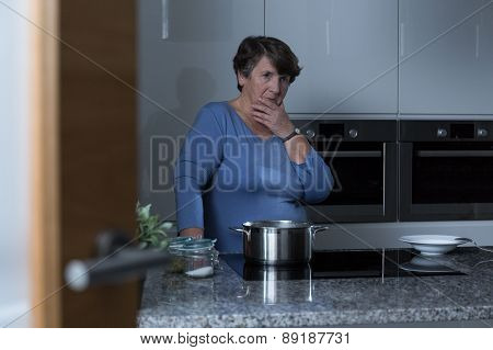 Elder Woman In The Kitchen