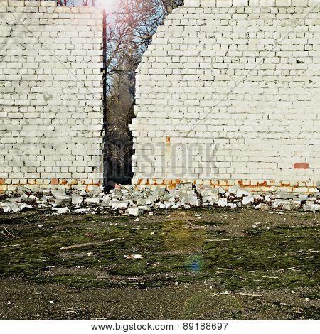 The Sun Shines Behind A Brick Wall