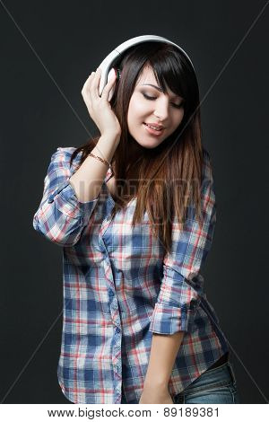 Young Brunette Woman Listening Music
